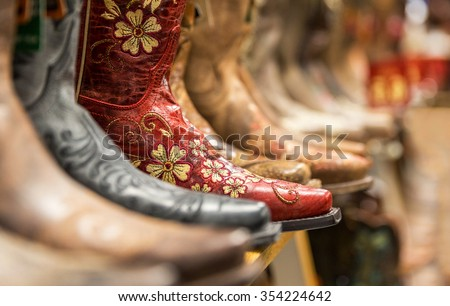 Cowboy boots in a store - Shutterstock ID 354224642