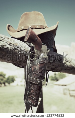 cowboy gun and hat outdoor under sunlight