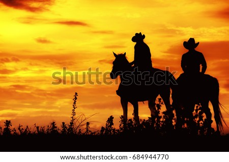Cowboy on horseback. ranch
