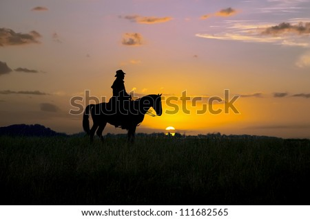 Cowboy sitting on his horse at sunrise. Montana