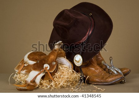 Cowboy theme props on khaki background fabric