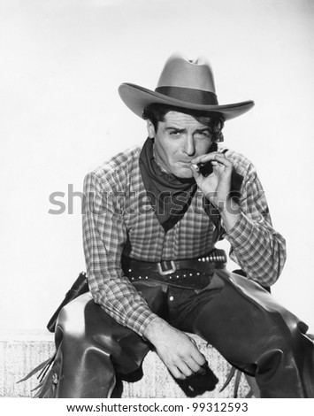 Cowboy with a cowboy hat smoking a cigarette