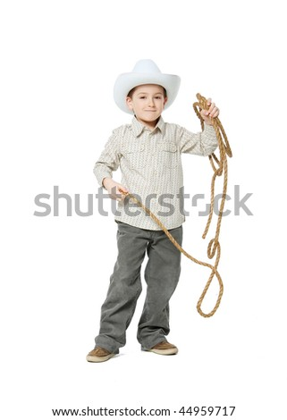 Cowboy with a lasso in the studio on a white background.