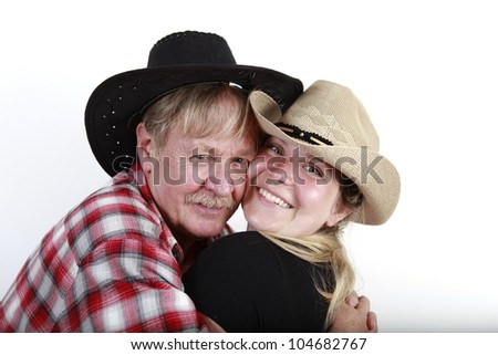 cowboy with his young blonde cowgirl