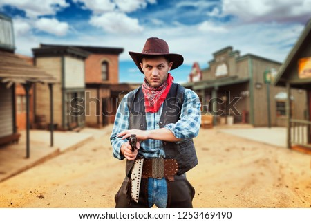 Cowboy with revolver, gunfight in texas country