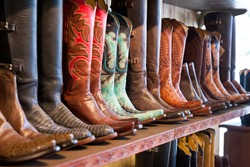 Cowboys boots on a shelf in a store, aligned