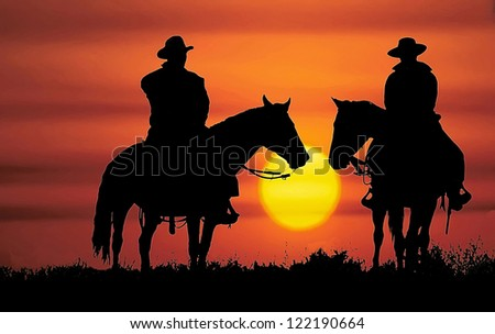 cowboys  on horseback ...