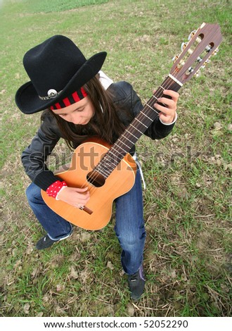cowgirl guitarist playing guitar