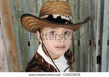 cowgirl in country outfit, old wooden background