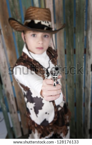 cowgirl in cowboy outfit, old wooden background