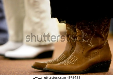Cowgirls in boots. - stock photo