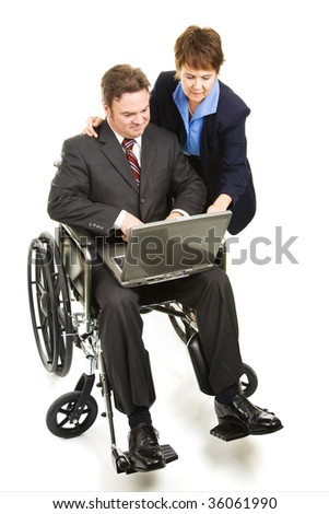 Coworker helps a disabled man with his laptop computer.  Full body isolated on white.