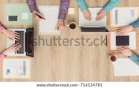 Coworkers and business team working together at office desk, cooperation and meetings concept #716124781
