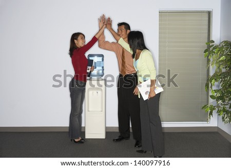 Coworkers exchanging a high five