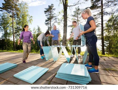 Coworkers Making Pyramid With Wooden Planks On Patio #731309716