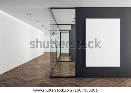 Coworking office interior with blank poster on black wall. Mock up, 3D Rendering