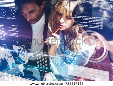 Coworking process in a sunny office.Young Business team making discussing at office.Concept of digital diagram,graph interfaces,virtual screen,connections icon.Horizontal,blurred background.Cropped #725319163
