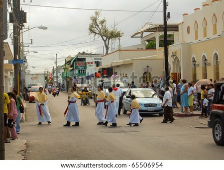 COZUMEL, MEXICO - APRIL 8: Procession of people pass through the city on April 8, 2007 during Easter Mass celebrations.  It is an annual Easter Sunday ceremony in Cozumel, Mexico
