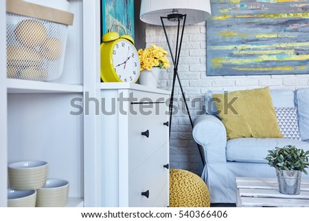 Cozy and modern living room interior decorated with yellow accessories