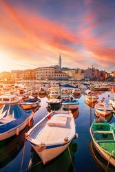 Cozy and quiet town of Rovinj with beautiful colorful houses on the Istrian peninsula, Adriatic sea at sunset  in Croatia