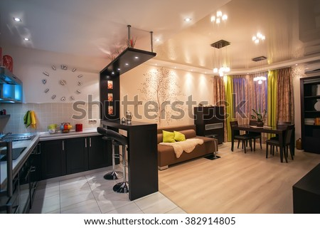 Cozy apartment in beige tones. Room Facilities Studio. Kitchen with dining room. interior, apartment, wall clock, design, architectural design, style, color, yellow, blue, ceiling, floor