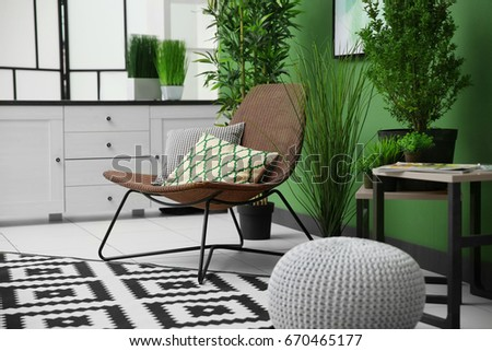 Cozy armchair in modern green interior