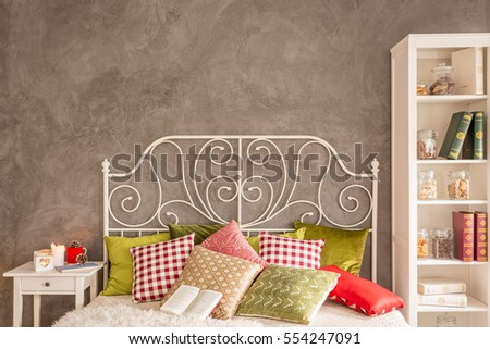 Cozy bedroom with bed with decorative metal headboard #554247091