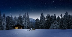 cozy blockhouse in wintertime at night