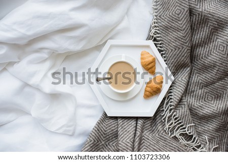 Cozy breakfast in bed, cup of coffee and croissants on white and #1103723306
