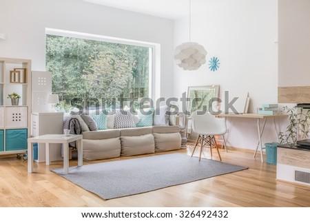Cozy bright living room and big window #326492432