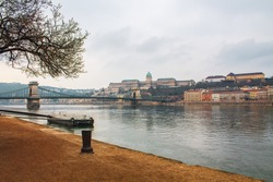 Cozy Budapest morning in the foreground Historical Royal Palace - Buda Castle along the Danube River in Hungary