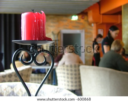 cozy cafeteria interior and foreground candle