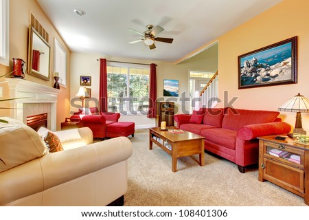 Cozy classic peach and red beautiful living room with fireplace. #108401306