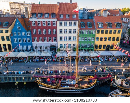 Cozy famouse colorful houses Nyhavn New Harbour canal and entertainment district in Copenhagen, Denmark. Street on the canal. Aerial view from the top