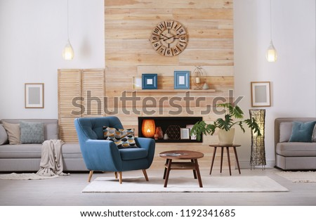 Cozy furnished apartment with niche in wooden wall and armchair. Interior design #1192341685