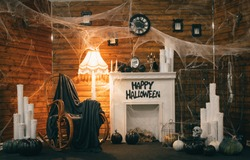 Cozy Halloween decorations with a fireplace and festive attributes. Photozone for Halloween. Background
