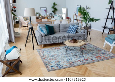 Cozy interior design of the studio apartment in Scandinavian style. A spacious huge room in light colors. stylish expensive luxury furniture.