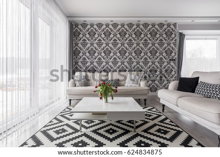 Cozy living room with white sofas and patterned carpet #624834875