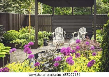 Cozy lounge furniture on landscaped garden terrace.