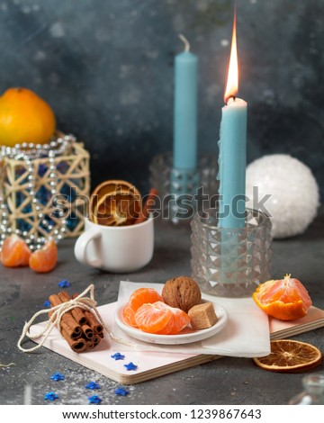 Stock Photo Cozy new year christmas table with candles, fir-tree branches, christmas lights and magic