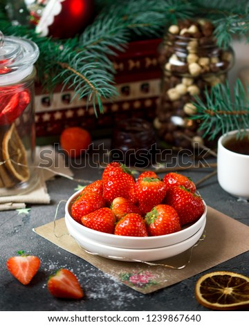 Stock Photo Cozy new year christmas table with candles, strawberry, coffe, fir-tree branches, christmas lights and magic