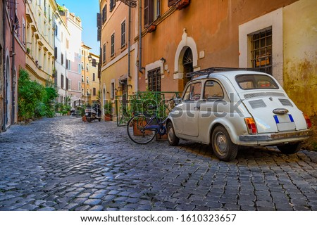 Photo of  Cozy old street in Trastevere in Rome, Italy. Trastevere is rione of Rome, on the west bank of the Tiber in Rome, Lazio, Italy.  Architecture and landmark of Rome