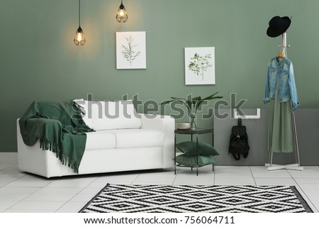 Cozy room interior with carpet on floor