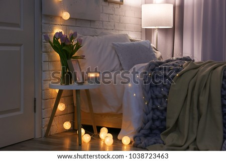 Cozy room interior with comfortable bed. Modern house design #1038723463