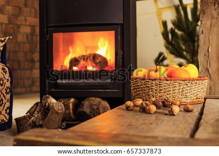 cozy room with fireplace and apple basket #657337873