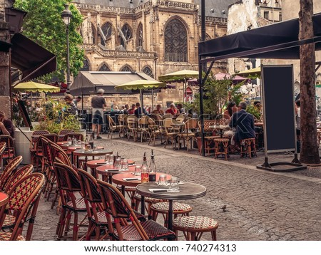cozy street with tables of cafe ...