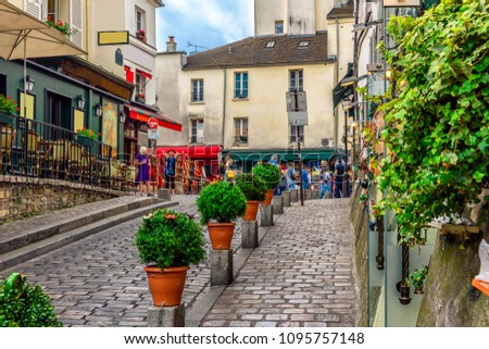 Cozy street with tables of cafe in quarter Montmartre in Paris, France. Architecture and landmarks of Paris. Postcard of Paris #1095757148