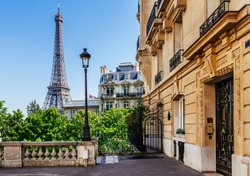 Cozy street with view of Paris Eiffel Tower in Paris, France. Eiffel Tower is one of the most iconic landmarks in Paris. Architecture and landmark of Paris