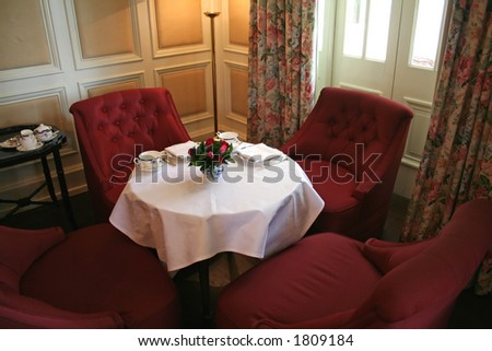Cozy tea corner; traditional English decor; afternoon tea laid out