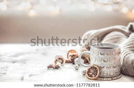 cozy winter composition with a cup and sweater on a light festive background #1177782811